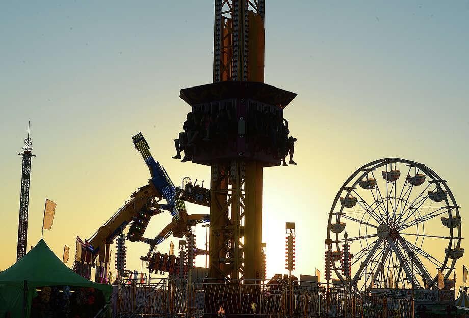 The carnival is silhouetted as the sun sets on the opening night of the 75th annual YMBL South Texas State Fair Thursday. The fair will run through April 1. Photo taken Thursday, March 22, 2018 Kim Brent/The Enterprise Photo: Kim Brent / BEN
