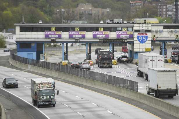 Cars pass through the New England Thruway Toll Plaza on the stretch of I-95 between New Rochelle and Larchmont, N.Y. Monday, April 24, 2017.