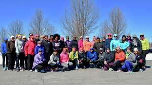 """Despite temperatures hovering around the freezing mark, more than 40 participants showed up Monday afternoon to the Freihofer?s Run for Women?s 1 p.m. Training Challenge session held at The Crossings of Colonie.  The 10-week program, which includes training sites in Albany, Greene, Rensselaer, Saratoga, Schenectady and Warren counties, is designed to help women get in shape for the 40th Freihofer's Run for Women on Saturday June 2.  The program includes a specific Training Challenge t-shirt; seminars and clinics relating to strength training, nutrition, injury prevention, running form and core strength; and, offers from program partners, including a free three-month CDYMCA membership, class discounts and much more. Participants can register for the program through April 1. """"The Freihofer's Training Challenge is designed to prepare you to run your best time at the Freihofer's Run for Women 5K,"""" said Freihofers Run for Women Co-Director Kristen Hislop. """"We offer a beginner program for those who are new to running. Our intermediate program is a great option for those who completed last year's challenge or want more interval workouts. Our advanced program is for those athletes ready for focused speed and distance workouts. If you are already running five or more miles at a time, this is the track for you."""" For more information and to register, visit freihofersrun.com/ftc.htm (Edward Parham)"""
