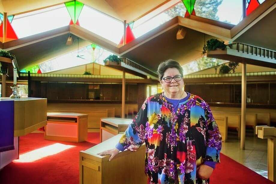 Deb Stark poses for a portrait inside St. John's Lutheran Church on Monday. (Katy Kildee/kkildee@mdn.net)
