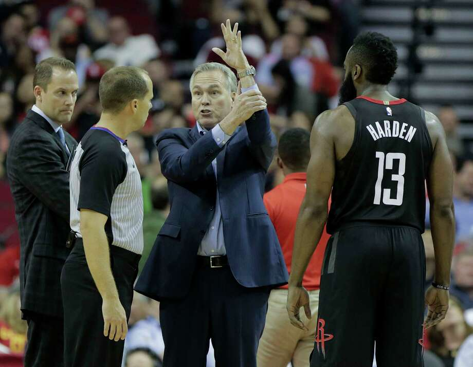 Houston Rockets head coach Mike D'Antoni tries to explain to official John Goble (30) how Houston Rockets guard James Harden (13) was fouled while putting up a shot to end the third quarter against the Detroit Pistons at Toyota Center on Thursday, March 22, 2018, in Houston. Rockets won the game 100-96 in overtime. Photo: Elizabeth Conley, Houston Chronicle / © 2018 Houston Chronicle