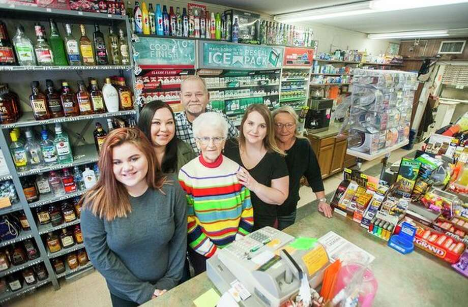 From left, Haley Hunter, Amber Hunter, Lanny Fick, Evelyn Fick, Ashley Rhodes and Donna Fick pose together for a portrait inside the store on Monday, March 12. (Katy Kildee/kkildee@mdn.net)