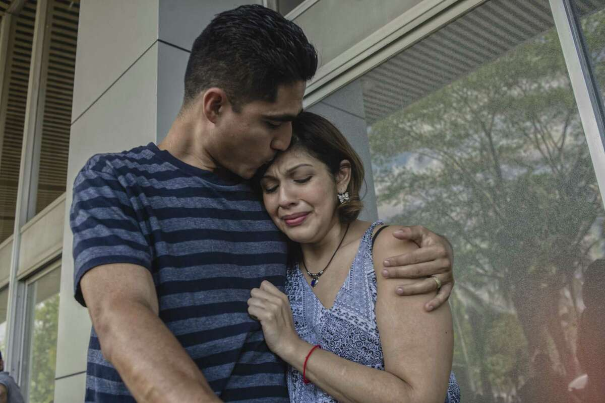 Jose Escobar embraces his wife Rosa after she arrived to El Salvador to visit him from Houston for the first time since his deportation. Escobar has been deported. He is the father of two, had no criminal record and a temporary protection from deportation but it was removed under President Donald Trumps executive order on immigration enforcement.