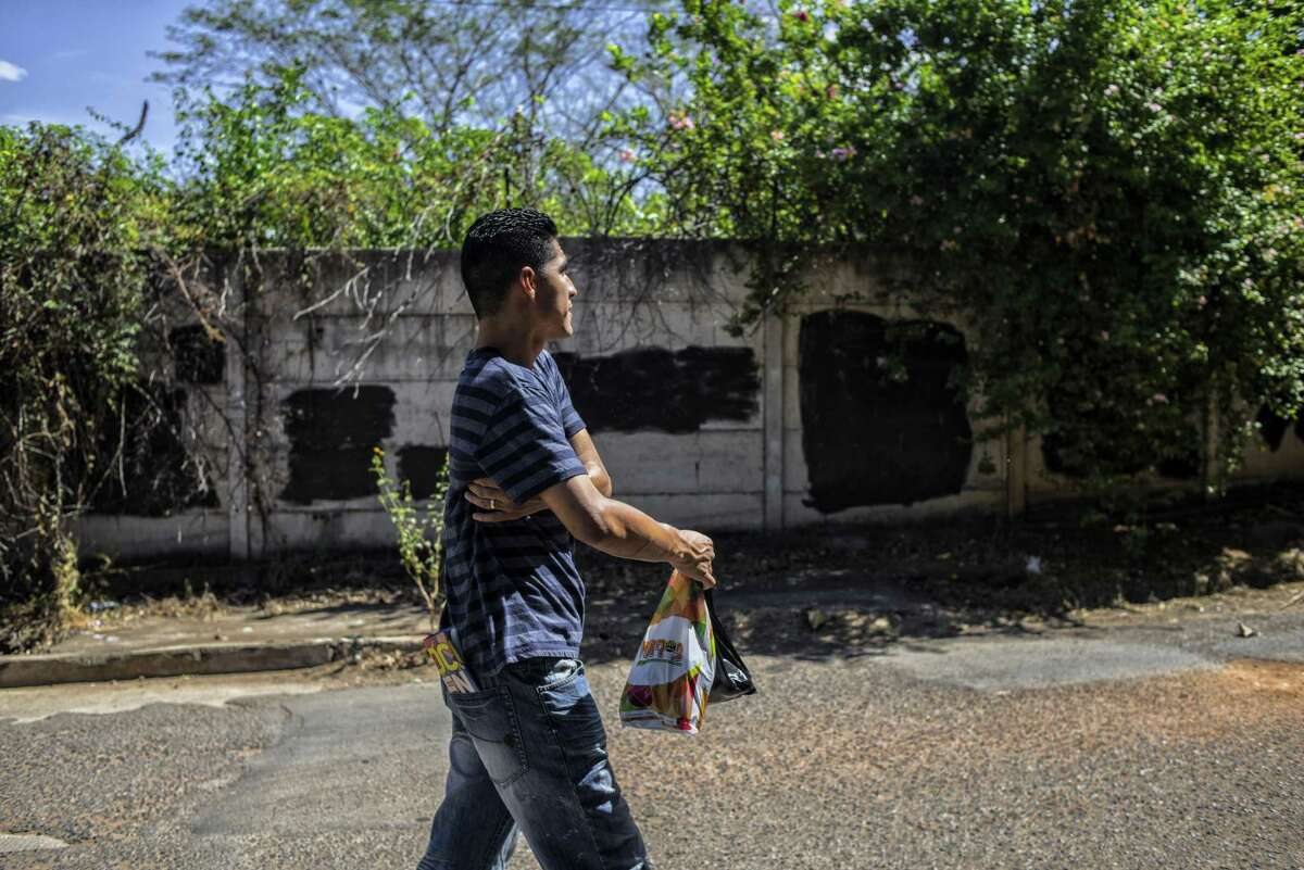 Jose Escobar walks in the community of Las Flores, which is controlled by the Barrio 18 gang. He has been living with his aunts since his arrival to El Salvador after being deported from the United States. He is the father of two, had no criminal record and a temporary protection from deportation but it was removed under President Donald Trumps executive order on immigration enforcement.