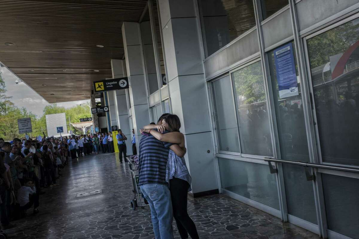 Jose Escobar greets his wife Rosa as she arrives to El Salvador to visit him from Houston for the first time since his deportation. Escobar has been deported. He is the father of two, had no criminal record and a temporary protection from deportation, but it was removed under President Donald Trumps executive order on immigration enforcement.