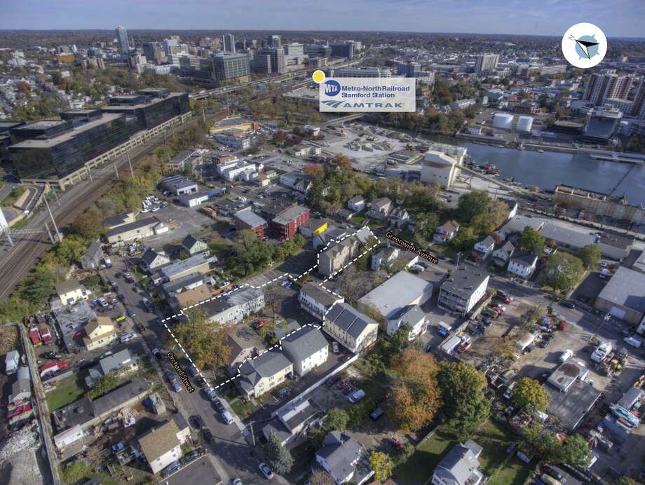 A six-building group of apartments in Stamford's Waterside section, at 20-24 Orchard St. and 275 Greenwich Ave., has sold for $5.25 million. Photo: /