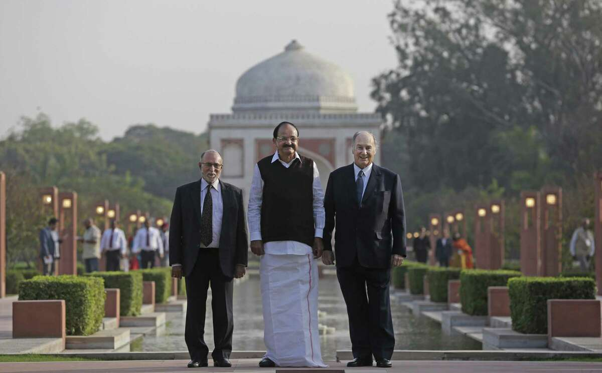 Aga Khan, right, spiritual head of Ismaili Muslims and the founder Chairman of Aga Khan Development Network stands with Indian Vice President Venkiah Naidu, center, and Lieutenant Governor of Delhi Anil Baijal as they pose for photos after arriving for the inauguration of Sunder Nursery in New Delhi, India, Wednesday, Feb. 21, 2018. Sunder Nursery was founded over 100 years ago by British colonists to grow experimental plants, has been revamped by the Aga Khan Trust for Culture in collaboration with the Central Public Works Department, Archaeological Survey of India and other agencies to create a 90-acre city park.