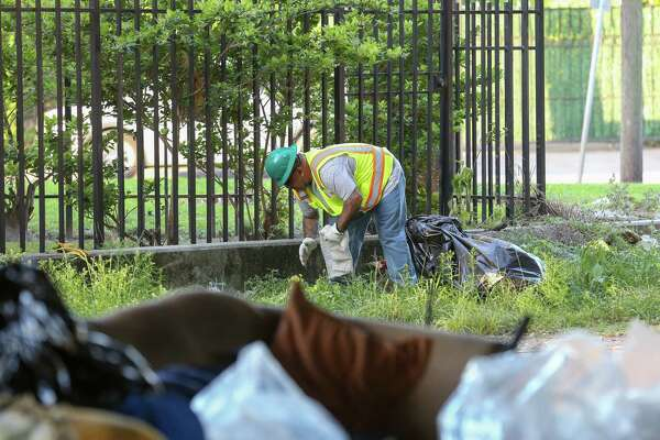 Clean up crews with the city conduct a deep cleanup of the Wheeler Homeless Encampment located under the US 59 Freeway, between Caroline Street and Almeda Road Friday, March 23, 2018, in Houston.