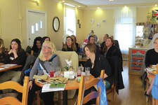 Some of the women who attended the Women Empowering Women meeting at The Queen's Cuisine Tea Room. The group will meet next month at Wang Gang.