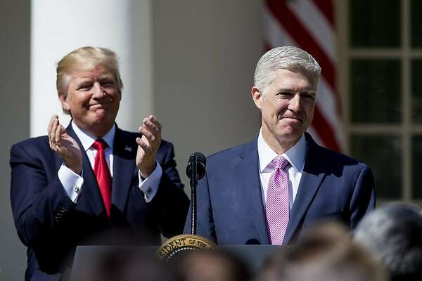 WASHINGTON, DC - APRIL 10:  U.S. Supreme Court Justice Judge Neil Gorsuch speaks as President Donald Trump looks on during a ceremony in the Rose Garden at the White House April 10, 2017 in Washington, DC. Earlier in the day Gorsuch, 49, was sworn in as the 113th Associate Justice in a private ceremony at the Supreme Court. (Photo by Eric Thayer/Getty Images) ***BESTPIX***