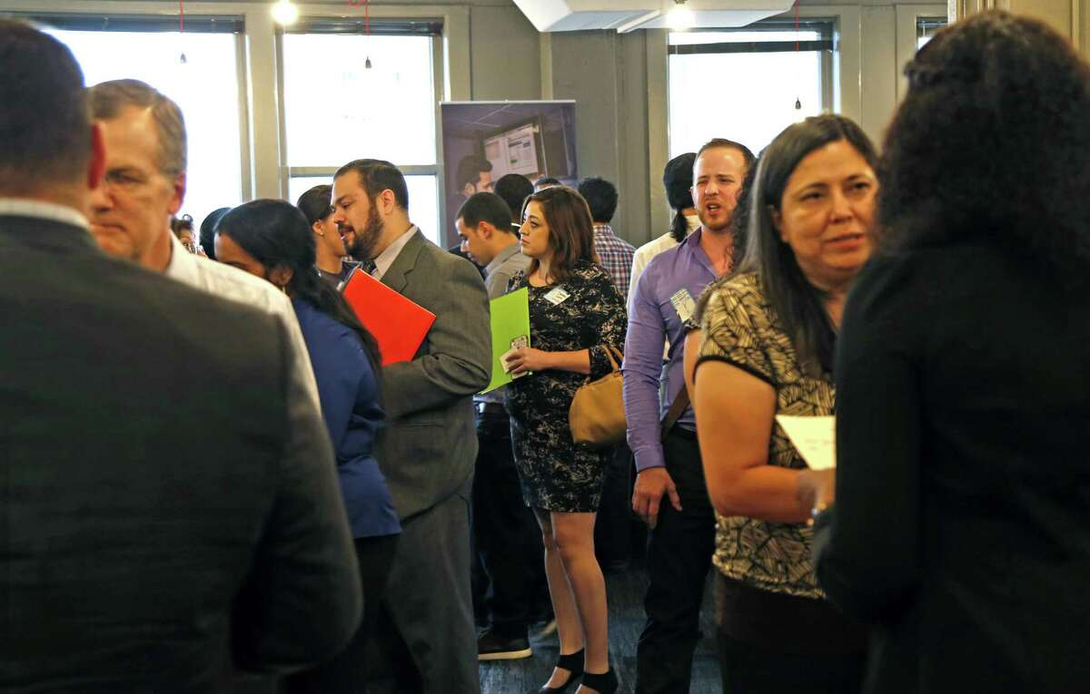 Job Seekers wait to talk to companies at a job fair hosted by Geekdom.