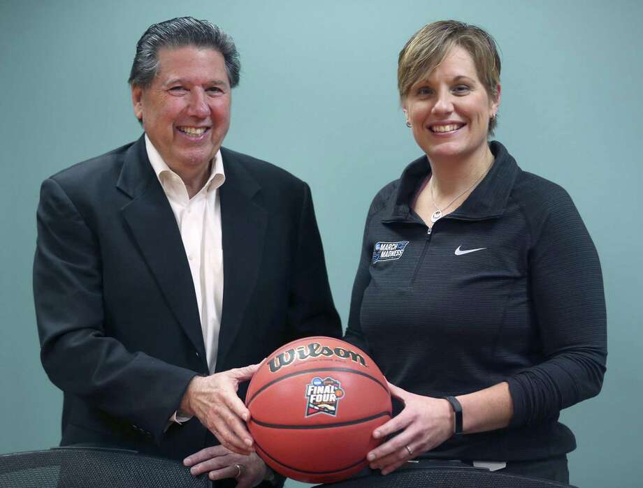 San Antonio Sports President and CEO Russ Bookbinder, left, and SA Sports' Executive Director of the San Antonio Local Organizing Committee for the 2018 Final Four Jenny Carnes pose Wednesday, Feb. 14, 2018 in San Antonio Sports' offices in the Alamodome. Photo: William Luther, Staff / San Antonio Express-News / © 2018 San Antonio Express-News