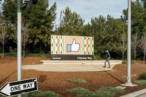 A billboard with the Facebook like icon outside the entrance to their offices in Menlo Park, Calif., Feb. 4, 2018.