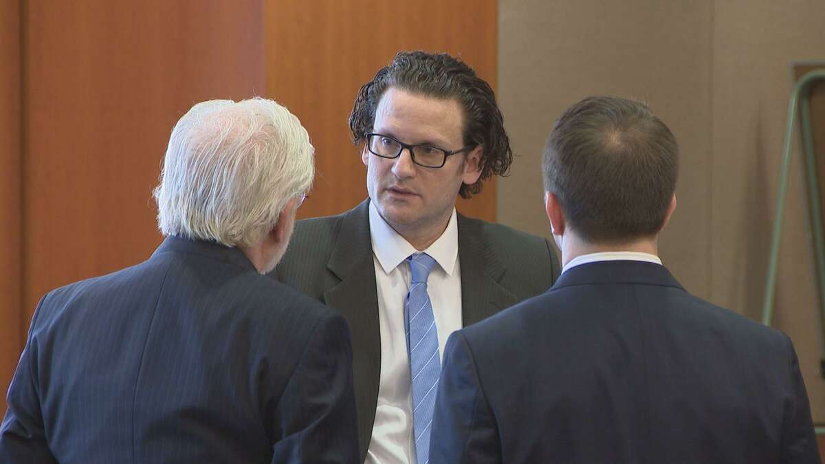 Leon Jacob, 40, talks to his attorneys, George Parnham (left) and Matthew Pospisil during Jacob's solicitation of capital murder trial on March 22, 2018.