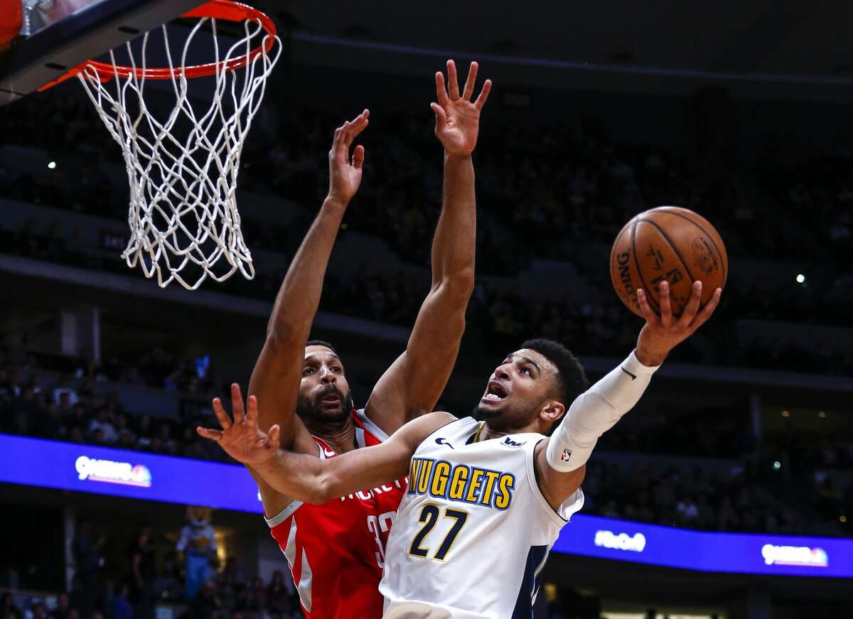 Denver Nuggets guard Jamal Murray (27) goes up for a shot against Houston Rockets forward Brandan Wright (32) during the third quarter of an NBA basketball game, Sunday, Feb. 25, 2018, in Denver. (AP Photo/Jack Dempsey)