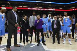 """Sacramento Kings owner and chairman Vivek Ranadive, center, joined by players, coaches and management, expresses their """"deepest sympathies"""" to the family of Stephon Clark, after the team's NBA basketball game against the Atlanta Hawks, Thursday, March 22, 2018, in Sacramento, Calif. Clark, who was unarmed, was shot and killed Sunday by Sacramento police, who were responding to a call about a man breaking several vehicle windows. A demonstration and march through downtown Sacramento Wednesday wound its way to the Golden 1 Center, which had to lock the doors to keep the protesters out. The game was played after a delay, with many fans unable to get into the building. The Kings won 105-90. (AP Photo/Rich Pedroncelli)"""