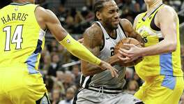 Kawhi Leonard helped the Spurs beat Denver in January.