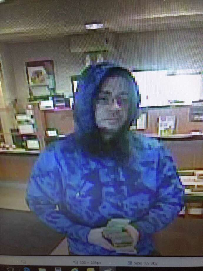 Colonie police are searching for information about the individual pictured in these images captured by video surveillance cameras during a robbery at the NBT Bank on Troy-Schenectady Road in the town of Colonie on Friday, March 23, 2018. Photo: Colonie Police