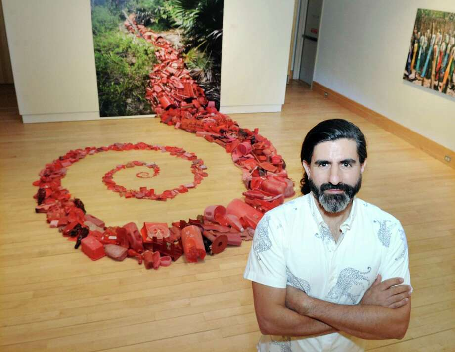 "Artist Alejandro Duran stands by his vinyl print and installation ""Vena."" Photo: Bob Luckey Jr. / Hearst Connecticut Media / Greenwich Time"