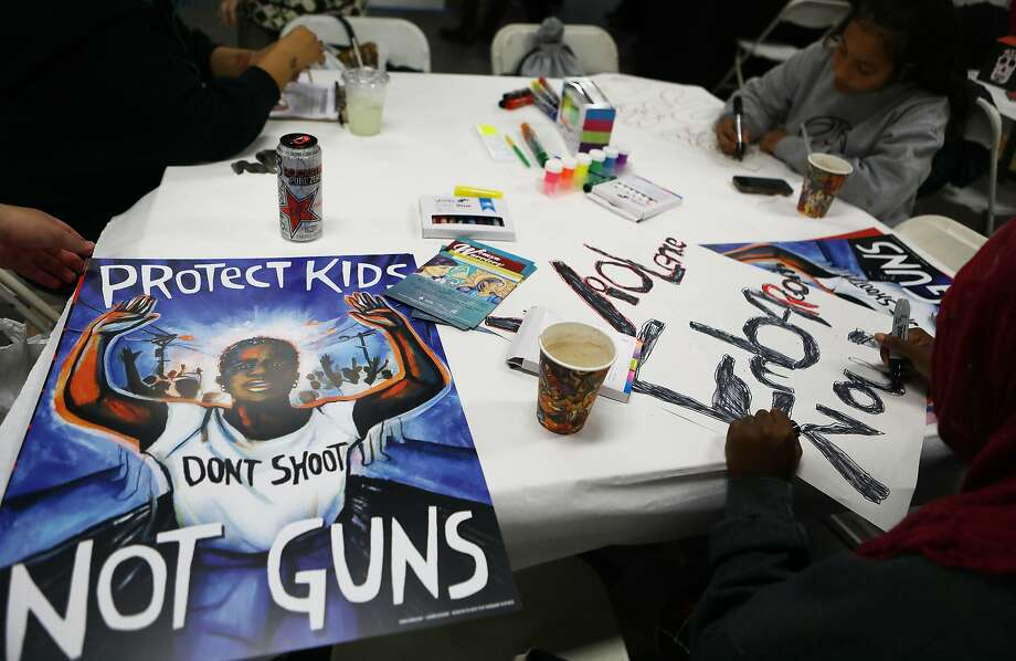 Young activists paint signs to be carried at the upcoming March for Our Lives in Los Angeles on Saturday. Photo: Mario Tama, Getty Images
