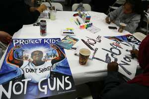 LOS ANGELES, CA - MARCH 22:  Young activists paint signs to be carried at the upcoming March for Our Lives Los Angeles on March 22, 2018 in Los Angeles, California. More than 500,000 are expected to march for gun control at rallies nationwide on March 24. The marches have been organized by students from Marjory Stoneman Douglas High School where 17 people were killed in a mass shooting February 14.  (Photo by Mario Tama/Getty Images)