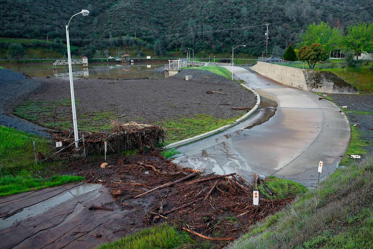Debris left behind after the emergency spillway was used in yesterday's water release from Moccasin reservoir in Moccasin, Calif., as seen on Fri. March 23, 2018. Officials issued a flash flood warning Thursday for south central Tuolumne County due to �imminent dam failure� at Moccasin Reservoir Dam in Tuolumne County.