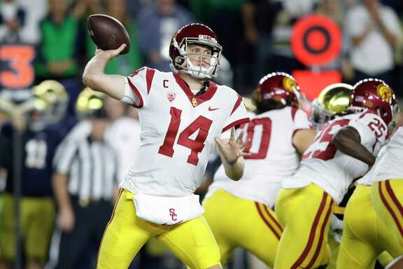 SOUTH BEND, IN - OCTOBER 21: Sam Darnold #14 of the USC Trojans throws a pass in the first quarter of a game against the Notre Dame Fighting Irish at Notre Dame Stadium on October 21, 2017 in South Bend, Indiana.