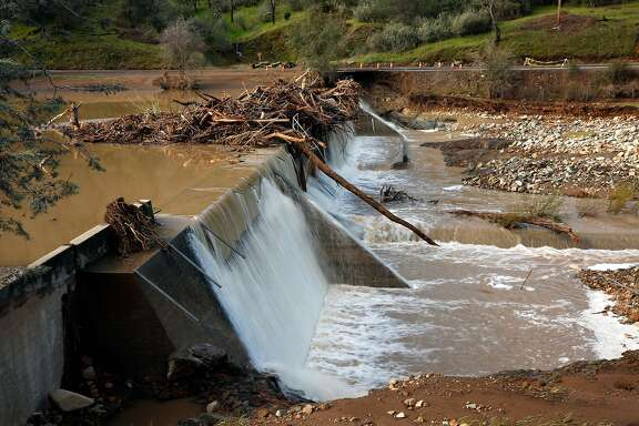 Moccasin Creek empties into Moccasin Reservoir as debris collected at a smaller dam in Moccasin, Calif., as seen on Fri. March 23, 2018. Officials issued a flash flood warning Thursday for south central Tuolumne County due to �imminent dam failure� at Moccasin Reservoir Dam in Tuolumne County.