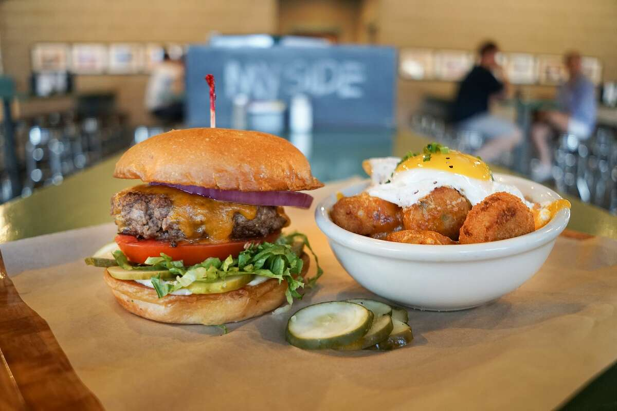 A large Rodeo Goat burger and one of their appetizers, dubbed