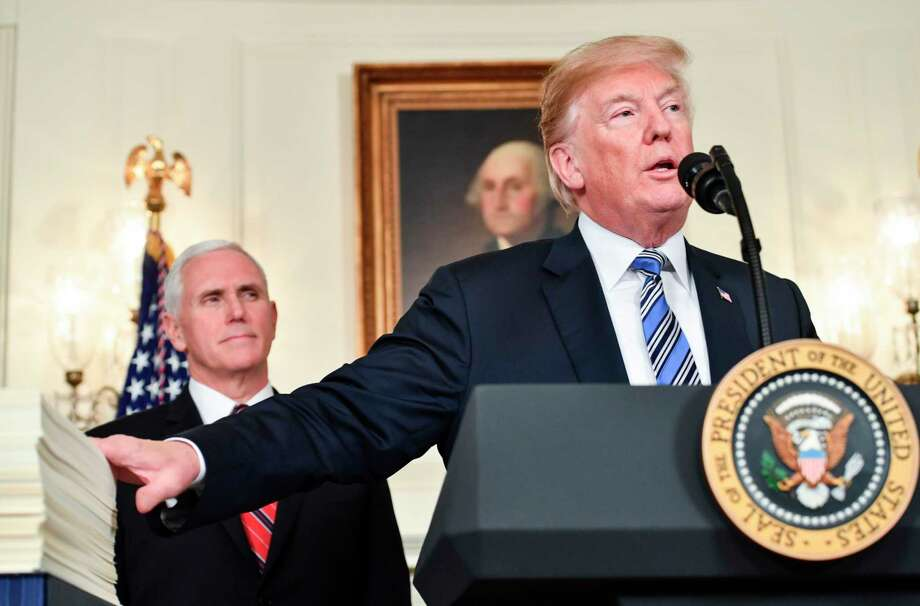 US President Donald Trump speaks about the spending bill during a press conference in the Diplomatic Reception Room at the White House on March 23, 2018.  / AFP PHOTO / Nicholas KammNICHOLAS KAMM/AFP/Getty Images Photo: NICHOLAS KAMM, AFP/Getty Images / AFP