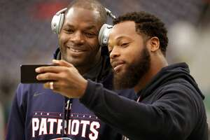 New England Patriots tight end Martellus Bennett, left, poses for a selfie with his brother Michael Bennett who plays for the Seattle Seahawks while on the field for pregame warm ups prior to Super Bowl LI at NRG Stadium in Houston on Feb. 5, 2017.