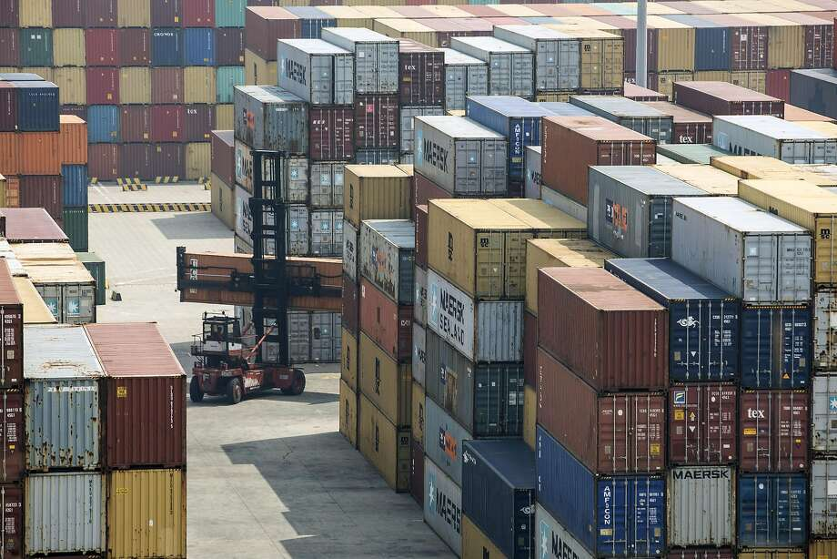 A reach stacker transports a shipping container in a terminal at the port in Shanghai, where many California exports go. Photo: Qilai Shen, Bloomberg
