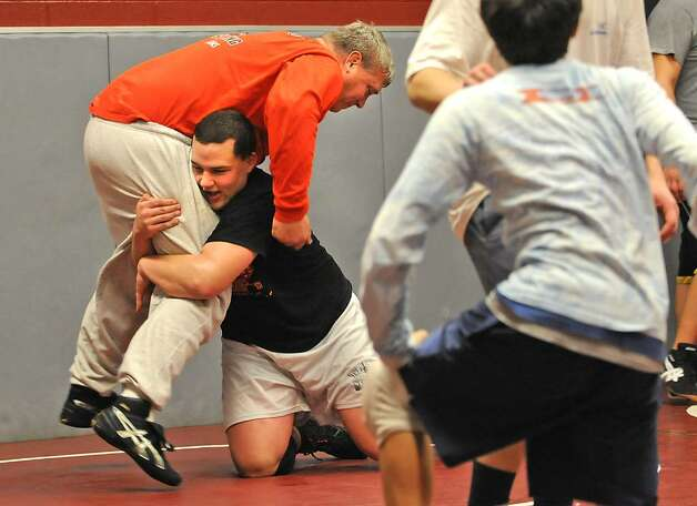 Former Olympian Jeff Blatnick works with Burnt Hills wrestler Zeal McGrew. (Lori Van Buren / Times Union) Photo: LORI VAN BUREN