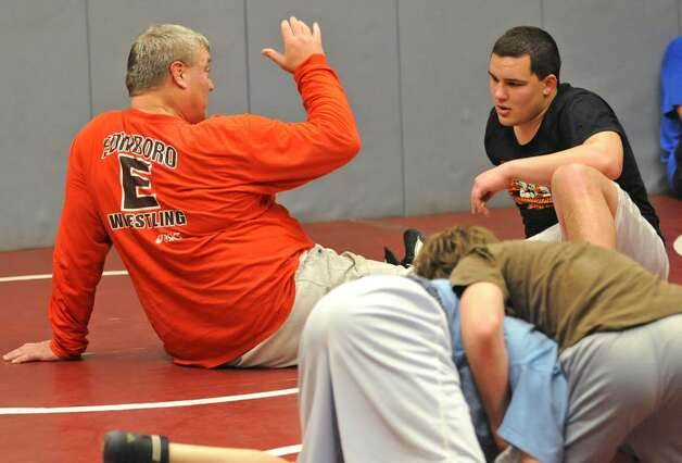 Former Olympian Jeff Blatnick, left, works with Burnt Hills wrestler Zeal McGrew. (Lori Van Buren / Times Union) Photo: LORI VAN BUREN