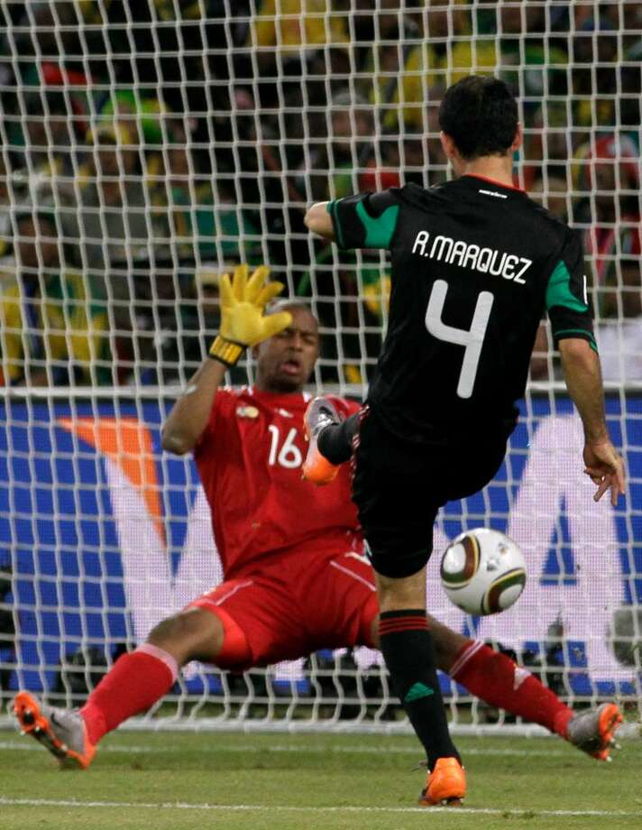 Player: Itumeleng KhuneGame: South Africa vs. UruguayOffense: Tripped Uruguay forward Luis Suárez inside the penalty area Photo: Guillermo Arias