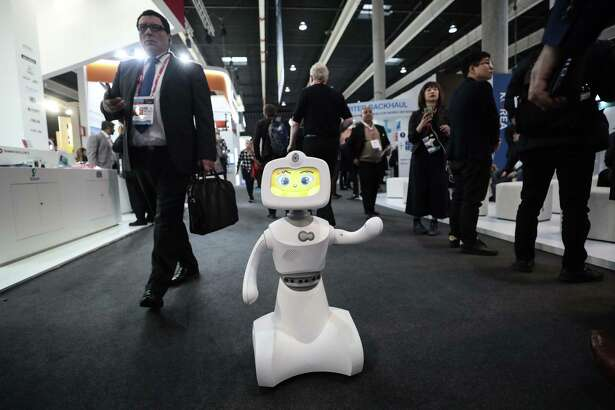 Robelf, a multi-camera home security robot, waves at opening day of the Mobile World Congress in Barcelona, Spain, on Feb. 26, 2018.