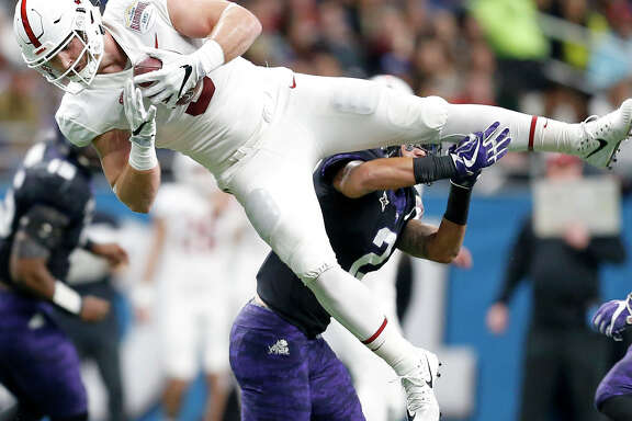 Stanford tight end Dalton Schultz (9) catches a pass over TCU safety Niko Small (2) during first half action of the Alamo Bowl held Thursday Dec. 28, 2017 at the Alamodome.
