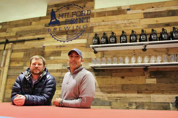 Chris Willett, left, and Jerry Candido are the owners of Milford Point Brewing Co.