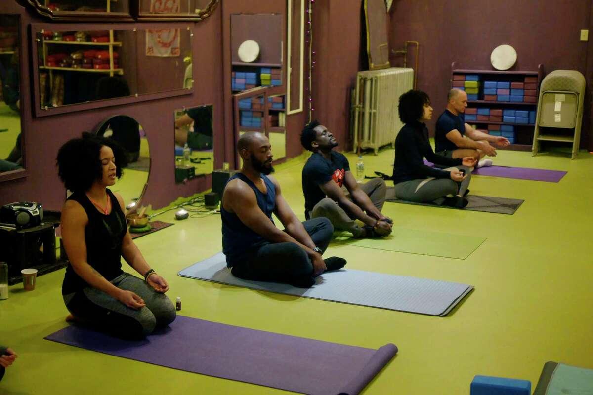 Rachelle Pean, far left, leads the Namaslay Sunday yoga class at Yoga Bliss on the Boulevard on Sunday, March 18, 2018, in Schenectady, N.Y. (Paul Buckowski/Times Union)