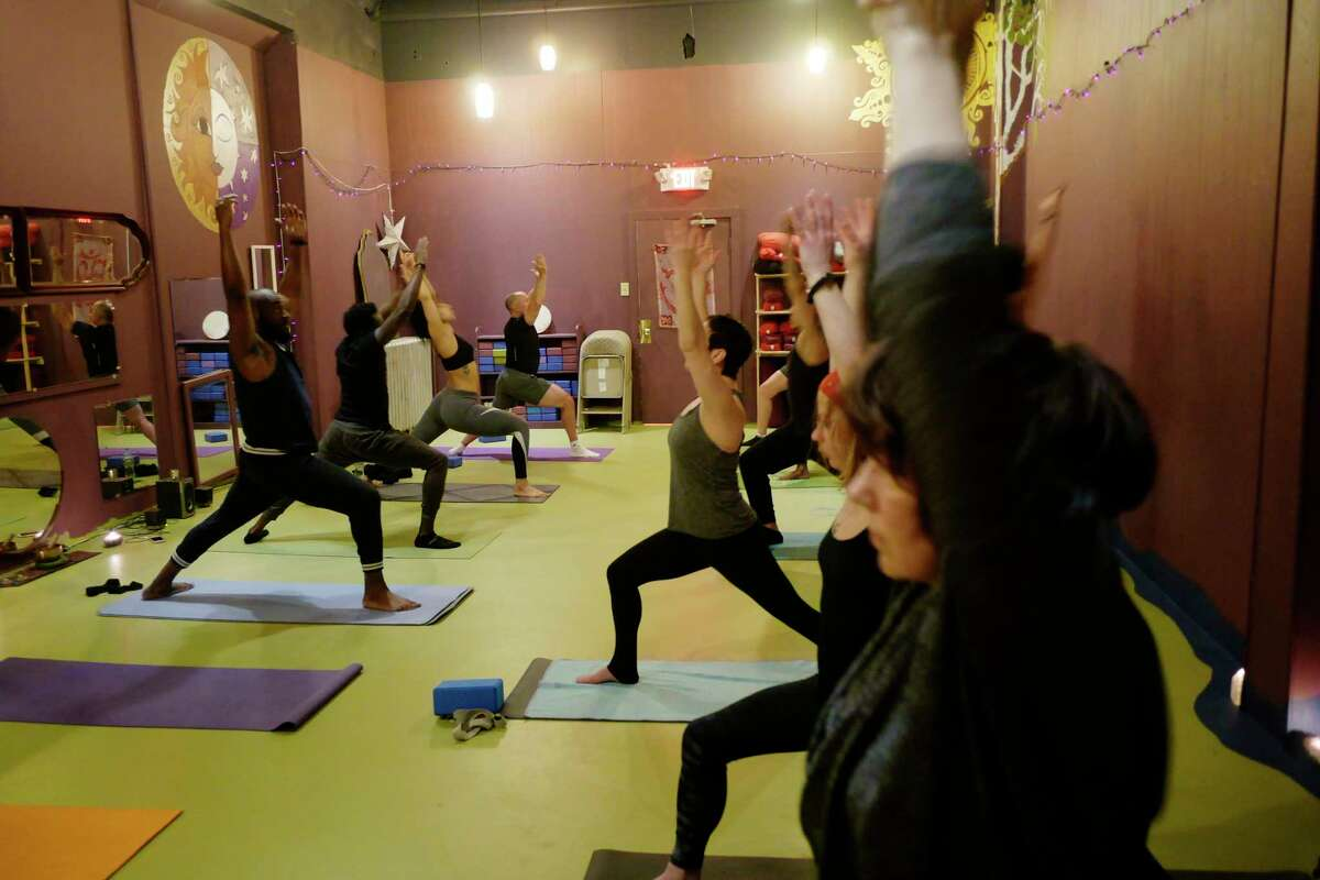 People take part in the Namaslay Sunday yoga class at Yoga Bliss on the Boulevard on Sunday, March 18, 2018, in Schenectady, N.Y. (Paul Buckowski/Times Union)