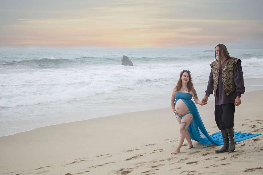 """Johanna Hill and her husband David of Prunedale, photographed by Gladys White Scott at Point Lobos. Johanna wanted the portraits to capture her """"mystical, sea witch side"""" and her husband's """"pirate lord-ness."""" Photo: Gladys White Scott / Bits Of Magic Image Studio"""