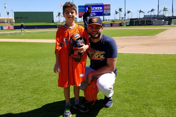 The Astros' Lance McCullers hangs out with Zachariah Katz (left) at the Astros' Fitteam Ballpark of the Palm Beaches on Thursday, March 22, 2018 in Palm Beach, Fla.