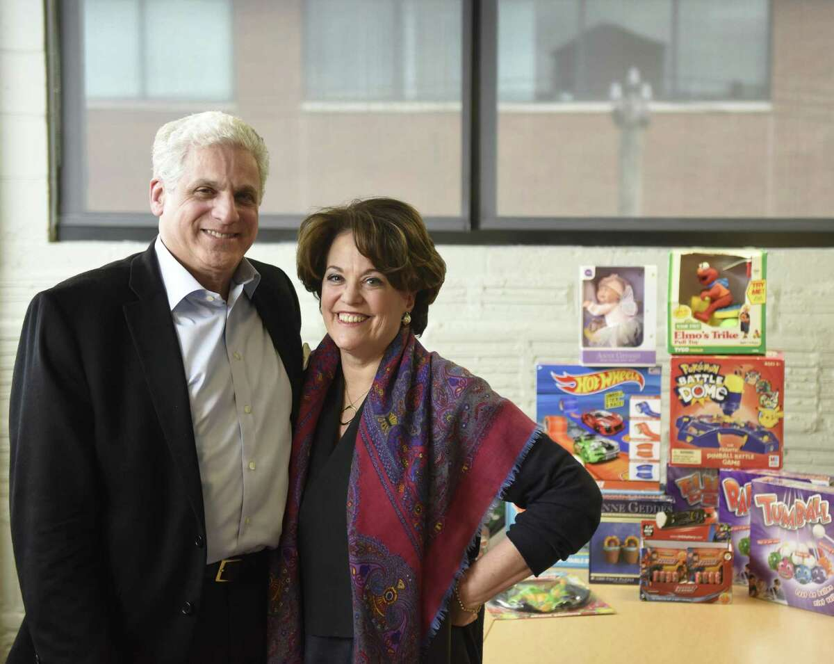Becker Associates CEO Patti Becker and Anjar International Licensing President Jonathan Becker pose with a variety of their licensed games at the Comradity co-working space in Stamford, Conn., on Thursday, March 8, 2018. Stamford-based Anjar is celebrating this year its 50th anniversary.