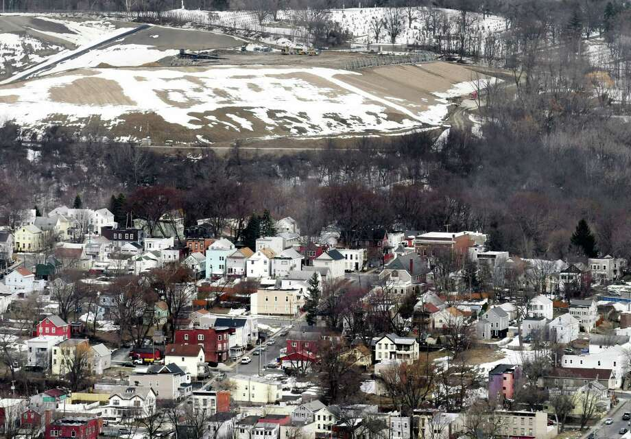 The Dunn C&D Landfill is visible above city houses on Tuesday, March 20, 2018, in Rensselaer, N.Y. In 2016, the landfill took in 407,975 tons of debris. (Will Waldron/Times Union) Photo: Will Waldron