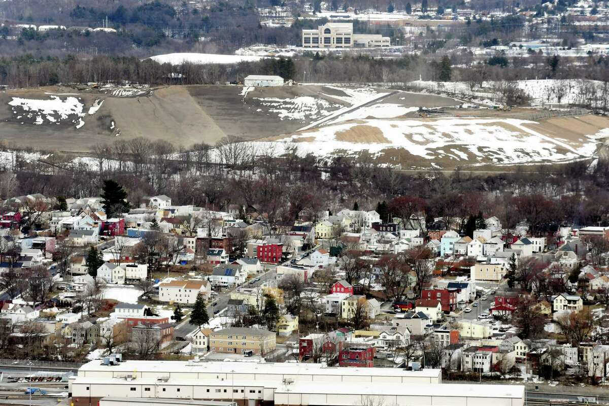 The Dunn C&D Landfill is visible above city houses on Tuesday, March 20, 2018, in Rensselaer, N.Y. In 2016, the landfill took in 407,975 tons of debris. (Will Waldron/Times Union)