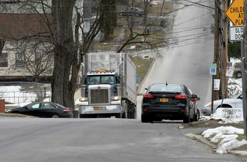Heavy truck traffic moves through Partition Street after dumping garbage at the Dunn C&D Landfill on Wednesday, March 21, 2018, in Rensselaer, N.Y. (Will Waldron/Times Union)