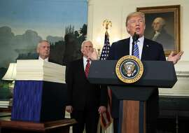 President Donald Trump with, Defense Secretary Jim Mattis, left, and Vice President Mike Pence, speaks in the Diplomatic Room of the White House in Washington, Friday, March 23, 2018, about the $1.3 trillion spending bill. (AP Photo/Manuel Balce Ceneta)