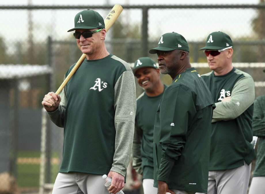 From left, Oakland Athletics manager Bob Melvin, special instructor Dave Stewart, and third base coach Matt Williams oversee a spring training baseball practice on Friday, Feb. 16, 2018 in Mesa, Ariz. Photo: Ben Margot / AP / Copyright 2018 The Associated Press. All rights reserved.
