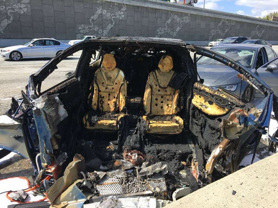 The blue Tesla was driving southbound on Highway 101 at freeway speeds near Highway 85, the CHP said, when it collided with a barrier separating the carpool lanes on both roads and caught fire. Photo: Jesse Gary/KTVU