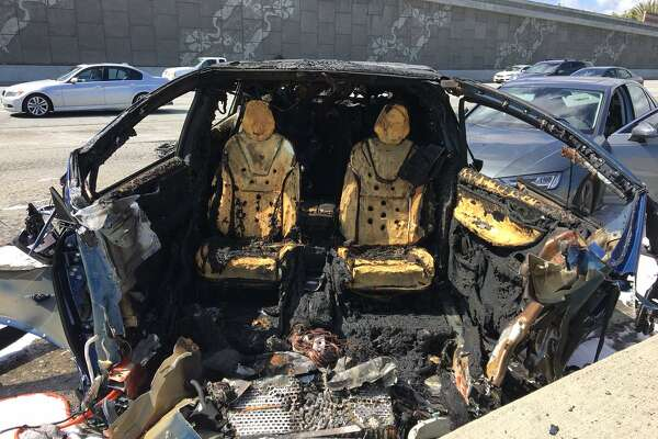 The blue Tesla was driving southbound on Highway 101 at freeway speeds near Highway 85, the CHP said, when it collided with a barrier separating the carpool lanes on both roads and caught fire.